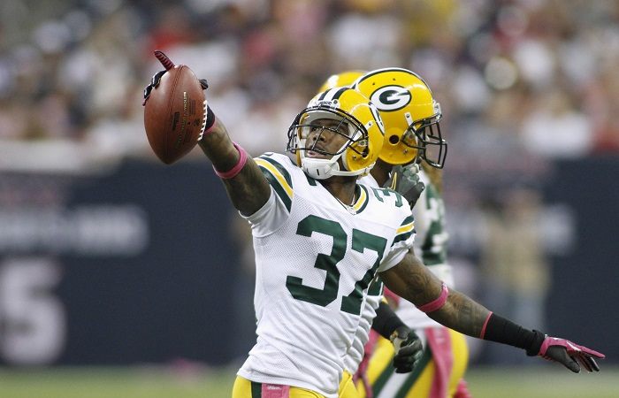 Green Bay Packers cornerback Sam Shields points to the stands as he celebrates an interception against the Houston Texans during their NFL game in Houston